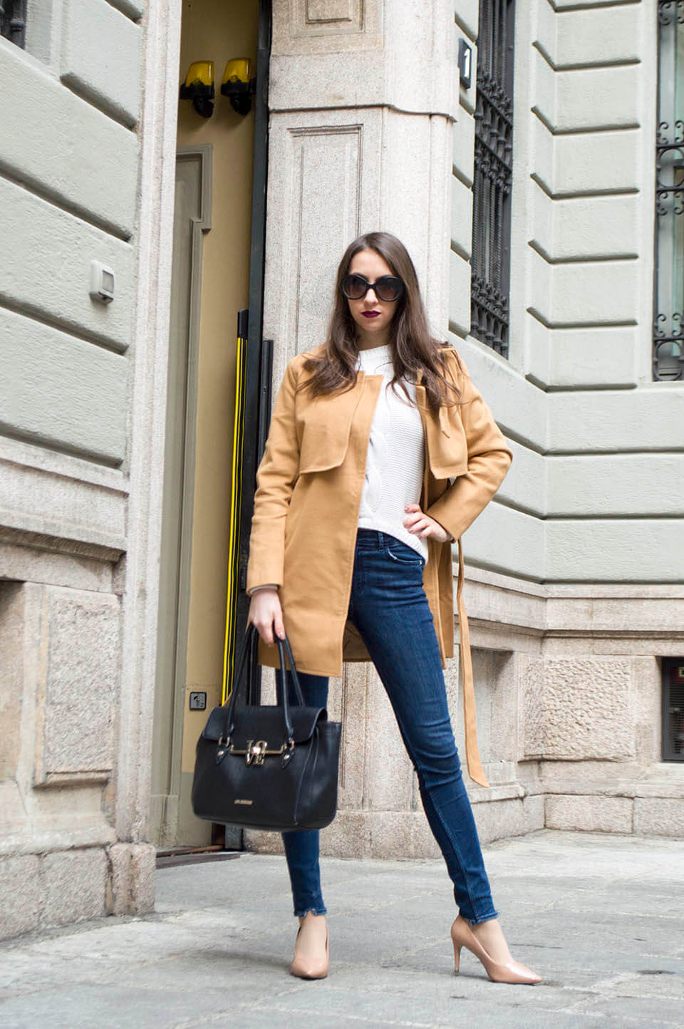 Camel coat outfit and denim pants