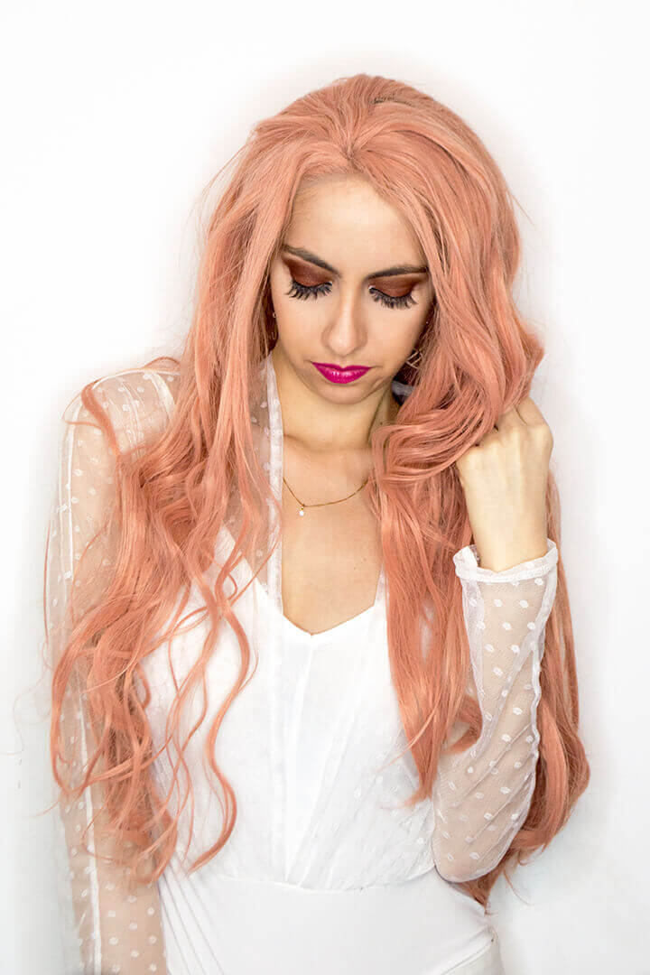 White bodysuit and pink hair